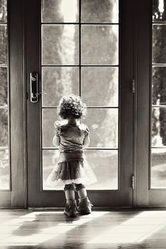 Lovely. Capturing the full size of the door in the photo accentuates the smallness of the child.