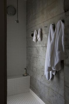 bathroom with concrete wall #towels #tiles