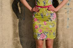 Green color dress with floral print and pink belt by Be Chic Fashion picture #2