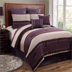 beige and purple bedroom with dark accent furniture