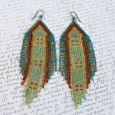 These seed bead earrings are my newest creation of native American inspired fringe earrings. This particular pair of beaded earrings is an