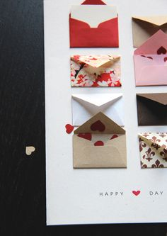 "Card with handmade tiny envelopes. Card size: 5"" x 7"". The tiny envelopes are made from various art paper and Japanese Chiyogami paper. There are 8 tiny envelopes on each card. Included are 6 tiny cards tucked into the little envelopes that allow you to write your own messages. The rest of the little envelopes contain mini heart confetti. ""I 'heart' U"" is the message printed on front. Inside blank. Logo on back."