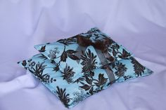 """Warm Hugs Microwave Heating Pads are reusable,non toxic,earth friendly warmers for all ages.♥ An all natural way to relieve stress, muscle tension, aches & pains or just to warm you on a cold day.Warmers are handcrafted with high quality 100% cotton fabrics and generously filled with whole corn provided by a local MN Farmer.Packaged """"Gift Ready"""" with instruction card.Sm/Lg Set online is $20.95, individual bags start at $8. www.warmhugs.com"""
