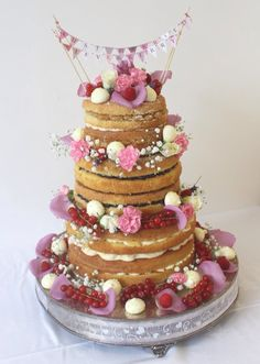 How to construct a naked wedding cake and make bunting #wedding #weddingcake #nakedweddingcake #baking
