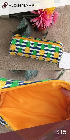 """Tropical Pineapples + Stripes Organizer Ideal for makeup or organizing smaller things in your tote bag! Super cute Pineapple design in faux leather set to blue and white stripes. Zipper at top with wipeable yellow nylon lining. Offers welcome. 8 x 5"""". Sal & Jo's Bags"""