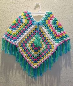 Crochet Patterns Poncho Some people think that wearing the sweater to stay warm ruins their fashion sens… Poncho Au Crochet, Crochet Poncho Patterns, Crochet Granny, Knit Crochet, Poncho Shawl, Vanessa Williams, Granny Square Poncho, Girls Poncho, Crochet For Kids