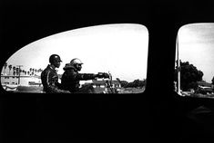 Motorcycle Men through Window / Ralph Gibson