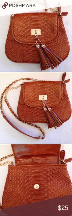 "Textured crossbody purse EUC Intricately embossed Big Buddha vegan bag. Cognac crossbody bag with gold accents. 10"" wide x 8"" tall, bottom expands to 3"" deep. Chain and faux leather strap is appropriately 46"". Lots of inside pockets. Very roomy for such a small bag, great for using at summer fairs and festivals. Big Buddha Bags Crossbody Bags"
