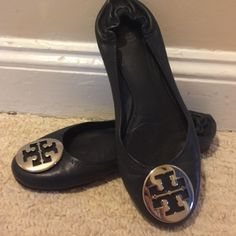 Tory Burch Navy Ballet Flats These are well loved flats. (I no longer have the box) a few minor scuff marks on the toes that can only be seen when the shoes are picked up. Otherwise still great condition. They are navy blue in color with silver logo. Tory Burch Shoes Flats & Loafers