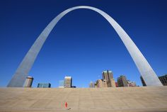 Jogger passes by Gateway Arch, Saint Louis, Missouri.