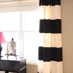 Painted canvas drop cloth curtains.