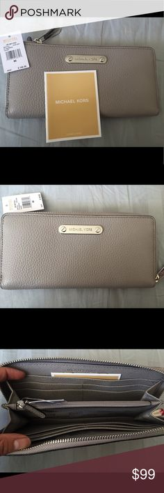 Michael Kors Pearl Grey ZA Continental Wallet New Michael Kors Pearl Grey ZA Continental Wallet  Features: 8 Credit Card holder, Organizer, Zip-Around Color: Grey Michael Kors Bags Wallets