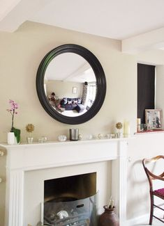 A well positioned mirror can do wonders for the home – adding light, space and interest. We are often asked for advice on choosing the right size mirror for the space. So, here are our 4 essential tips for hanging a round mirror above a fireplace. Above Fireplace Ideas, Mirror Above Fireplace, Fireplace Surrounds, Fireplace Mantle, Stone Mantle, Navy Living Rooms, Living Room Mirrors, Living Room With Fireplace, Living Room Decor