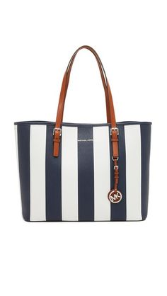 A MICHAEL Michael Kors tote rendered in awning-striped saffiano leather. Double handles and an open top. Unlined interior with 1 pouch and 1 zip pocket. Gold-tone hardware. Dust bag included.