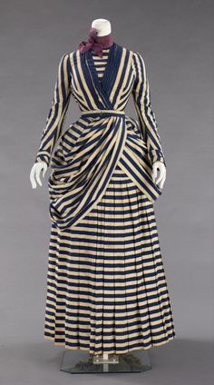 """Saturday. Seaside. Stripes, 1885–88. This American cotton & silk dress @MetMuseum would have been acceptable garb for yachting, tennis, or a seaside stroll. The stripes were considered stylish for these """"less formal"""" activities, and project a maritime sensibility. The dress is a bit shorter & embellishments have been reduced.   Acc. # Number: 2009.300.2477a, b"""