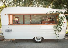 Let Sidecar mix custom craft cocktails out of our 1961 Shasta bar trailer at your next event - Tinker Tin's Vintage Trailer Rentals!