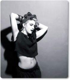 Madonna. Crop top and trackie dacks.