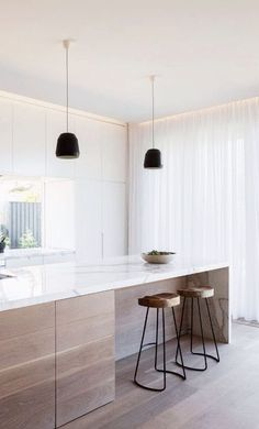 Sheer curtains provide the perfect background to this Kitchen. Shakespeare Design'a style is similar.