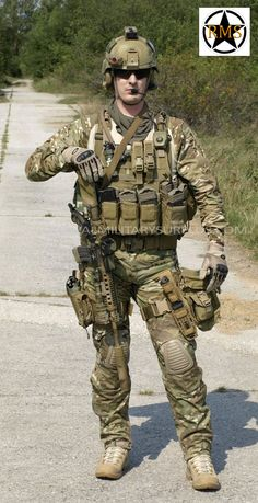 This Action Shot presents Military Uniforms and Tactical Gear in a Combat…