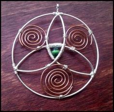 Silver plated and copper wire wrapped trefoil.