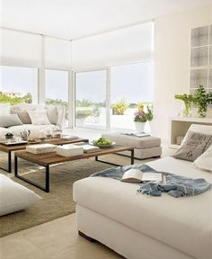 Cottage Chic Beach House Living Room. light, white, comfy seating and pair of rustic coffee tables, adore!