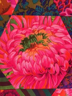 "Fussy cut hexagon block: Kaffe Fassett quilt by Mayleen; quilting by Jan Hutchison: ""The quilting isn't going to show up much in such a bright busy quilt.  I outlined the flowers in the blocks."""
