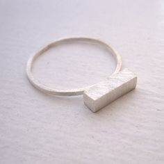 Thick Bar Ring, Sterling silver ring with 11mm brass bar, thin sterling silver ring, silver stacking ring 0105 by VirginiaWynne on Etsy https://www.etsy.com/listing/192849932/thick-bar-ring-sterling-silver-ring-with