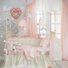 Baby will delight in a world of delicate pink and ivory. An elegant crushed satin bed skirt is magically textured like ripples on water. An ultra fine sheer netting is embroidered with dimensional chiffon cut flowers in antique white. Lined with a gorgeous silk-like fabric the color of petals, the quilt is finished with petite ivory piping. All fabrics have a subtle sheen for a beautiful play of light.