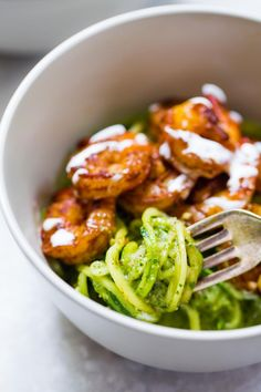 Shrimp with Pesto Noodles in a bowl with a fork.