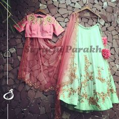 One of our very favourite designs in lovely hues of sea green and pink paired with gorgeous cutwork dupatta. Indian Dresses, Indian Outfits, Indian Clothes, Engagement Gowns, Indian Wear, Indian Style, Ghagra Choli, Lehenga, Sarees