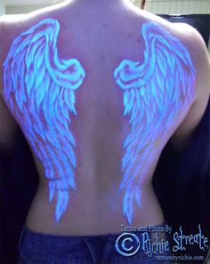 This would be amazing.. I've always wanted wings.. imagine no one being able to see your wings in broad daylight, but when you go to the club or party your wings shine bright! I wonder if it will work over existing tattoos?