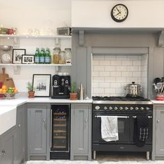 Grey & White Country Kitchen | Open Kitchen Shelves | Cooker Mantel | Metro Tiles | Interiors