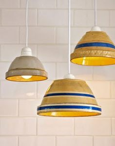 Bowl pendant lamps.  Drill very carefully through antique bowls.  Attach to hanging lamp kit.
