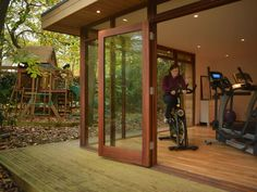 3.3m x 5.3m Garden Gym in London for around £22000. Built in January 2012 this Cube style building includes remote control lighting and designed to blend into a wooded area