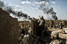 Marines take positions on a rooftop, to scan for insurgents during Operation Phantom Fury in Fallujah, Iraq, November Afghanistan War, Iraq War, Military Photos, Military History, Radios, Us Marines, Thing 1, History Photos, Modern Warfare