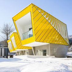 Asymmetric holiday homes by Studio Koossino feature bright yellow walls. Repinned by iFactory.com.au #ifactory #architecture