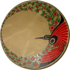 Hand Painted Native Designed Drums: Hummingbird and Dogwood Large Drum  by Danny Dennis.   Sa-Cinn (hummingbird) bringer of love luck and joy has been combined with the BC. Flower  Dogwood. The Artist has painted this Drum with Indian ink.