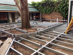 This deck frame around a tree is low set to the ground and being installed around a tree. This area is a new outdoor courtyard entertaining area at Mittagong Hotel. The framing is Boxspan steel beams and will be decked with hardwood timber decking.