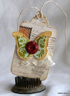Love the postcard tag. . . butterflies . . . and bits of lace!!! (I have this paper!)