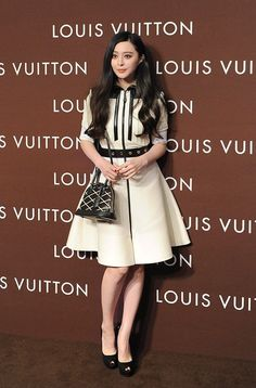 Chinese actress Fan Bingbing unveiled the new Louis Vuitton flagship store in Chengdu, China, July 3, 2014 with actor Huang Xiaoming, photographer Chen Man and model Lv Yan