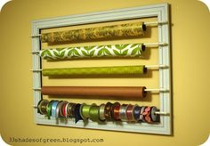 "..Wrapping Paper & Ribbon Wall Rack .What you'll need: - 36"" x 24"" open back frame (Mine came from Hobby Lobby and was 1/2 off) - (5) 28""-48"" cafe rods ($2.99 each @ Hobby Lobby) - spray paint - mounting hardware for frame see tutorial: 33 shades of green"