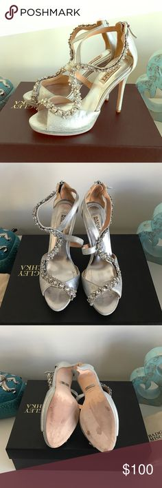 Badgley Mischka Rhinestone Silver pumps size 7.5 These are a pair of Badgley Mischka rhinestone silver pumps size 7.5 with a dust bag.  They are in excellent condition!  Perfect for a wedding or prom.  I wore these once on my wedding day during our photo shoot. Badgley Mischka Shoes Heels