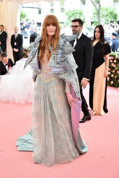 The 'Orange is the New Black' star walked the 2019 Met Gala red carpet in a striking all black Christian Siriano gown 'inspired by fantasy. Valentino Gowns, Versace Dress, Stem Challenge, Strapless Bustier, Met Gala Red Carpet, Florence Welch, Column Dress, Latex Dress, Gowns With Sleeves
