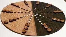Adomoc is a two-player, abstract strategy board game. Laser cut game board and playing pieces. Via: http://www.adomoc.com