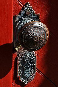 Antique Door Knob On Red Door