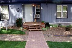 Before And After Photos Of A Small Front Yard Landscape Makeover Project Using WoodStone Decorative Rock