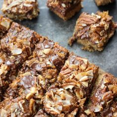 Baker Bettie's version of Hello Dolly Bars also known as Magic Bars! Dark Chocolate 7 layer bars with a whiskey caramel sauce! Hello Bettie! Have you heard of a 'Hello! Dolly Bar?' Or maybe you…