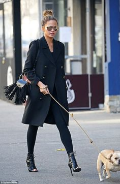 Puppy love: The looker followed her dog Pippa that same day in New York City...