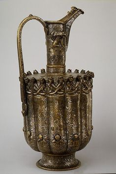 Date:  ca. 1180–1210                                                       Geography:                                      Iran, Khurasan                                                       Culture:                                      Islamic                                                       Medium:                                      Brass; raised, repoussé, inlaid with silver and black compound