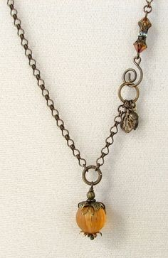 Fall pumpkin necklace. Ooh, and I have some lovely lamp work pumpkins from Fire & Sand.